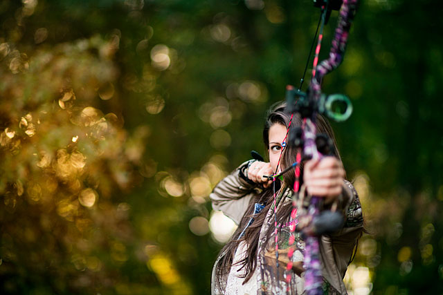 outdoor-portrait-woman-bow-hunting-photographer-editorial-nature-woods-forest-deer-aim-commercial-people-michigan-rural-metro-detroit-oakland-parks-s