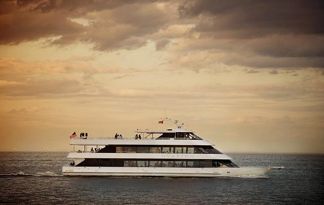 Advertising transportation photograph of a yacht at sunset on Lake Michigan in Detroit