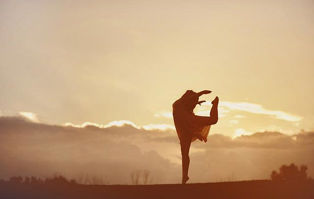 lifestyle advertising silhouette photograph of ballet dancer at sunset