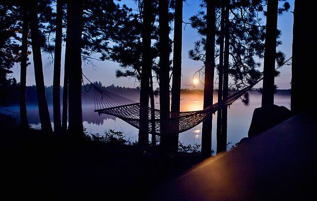 leisure travel hammock on the lake in the woods