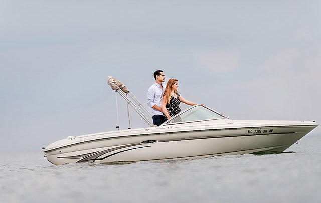 Lifestyle advertising and commercial action Photographer - couple on a speed boat in Michigan
