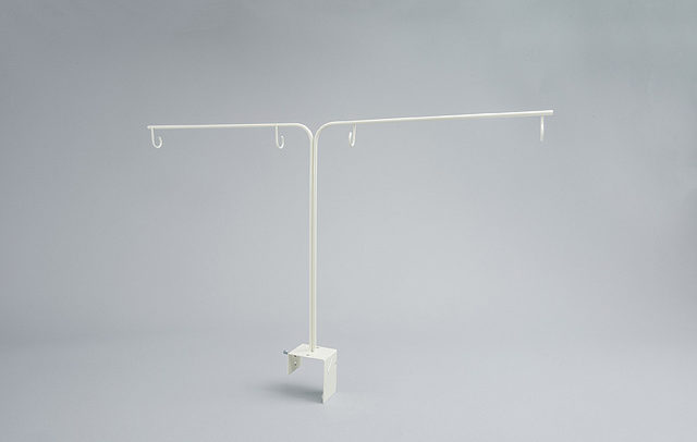 Product photograph of display holder on grey backdrop
