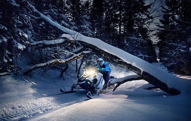 Action advertising and commercial sports photograph snowmobiling in Michigan's Upper Peninsula